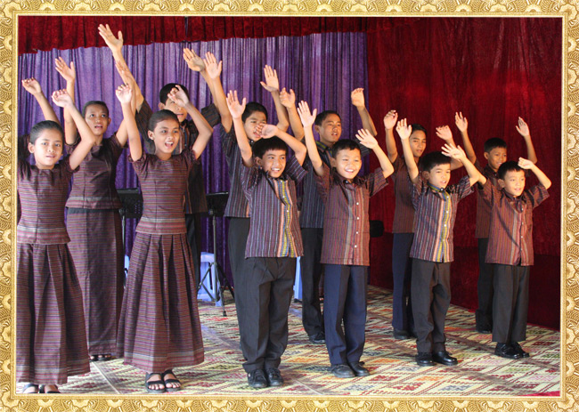 A photo of a group of children performing a dance at the Cambodian Christian Arts Ministry